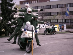 Men Balancing on a Motorcyle